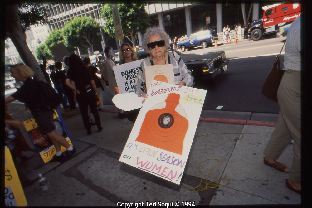 The OJ Simpson trial and media circus.<br /> Protestor out front of the Criminal Courthouse.