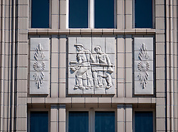 Ornate detail on facade of old socialist GDR era apartment buildings on Karl Marx Allee in former East Berlin Germany