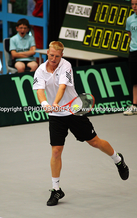 Daniel King-Turner plays a backhand return in the doubles.<br /> Davis Cup Tennis - New Zealand v China at TSB Stadium, New Plymouth, New Zealand. Saturday, 20 September 2008. Photo: Dave Lintott/PHOTOSPORT