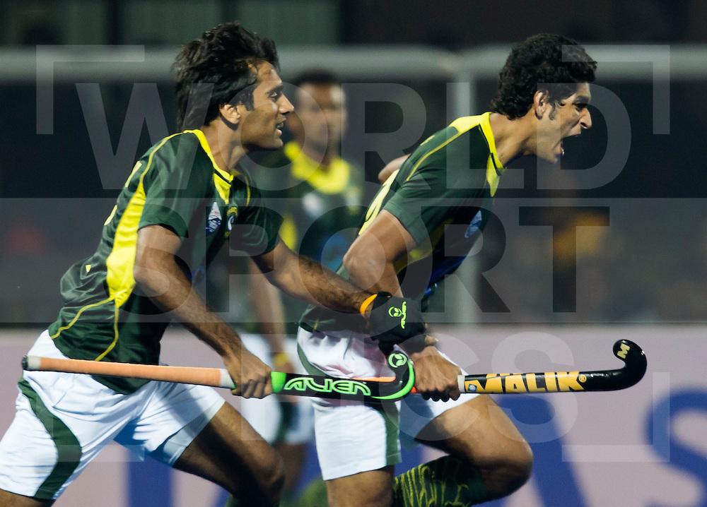 BHUBANESWAR (India) -  Hero Champions Trophy hockey men. Semifinal India vs Pakistan.  Muhammad Arlsan Qadir (r)  of Pakistan scored. Photo Koen Suyk