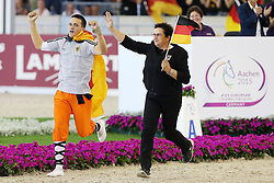 22.08.2015, Aachener Soers, Aachen, GER, FEI Europameisterschaften Aachen 2015, Finale Herren-Kuer, Voltigieren, im Bild Europameister Jannis Drewell (GER) jubelt zum Titel mit Pferd Diabolus 3 und Longenfuehrerin Simone Drewell (GER) // during Final Men, Vaulting of FEI European Championships Aachen 2015 at the Aachener Soers in Aachen, Germany on 2015/08/22. EXPA Pictures &copy; 2015, PhotoCredit: EXPA/ Eibner-Pressefoto/ RRZ<br /> <br /> *****ATTENTION - OUT of GER*****