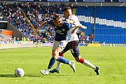 Gavin Whyte (20) of Cardiff City and Marvin Johnson (21) of Middlesbrough battle for possession during the EFL Sky Bet Championship match between Cardiff City and Middlesbrough at the Cardiff City Stadium, Cardiff, Wales on 21 September 2019.