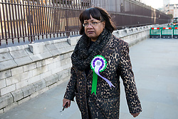 © Licensed to London News Pictures. 06/02/2018. London, UK. Shadow Home Secretary Diane Abbott walking through Westminster. She is wearing a rosette to celebrate the 100 year anniversary of women gaining the right to vote. Photo credit : Tom Nicholson/LNP