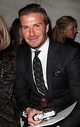 David Beckham with his camera  in the front row at the Victoria Beckham  show at New York Fashion Week AW 2012, Sunday , February 12th 2012.  Photo by: Stephen Lock / i-Images