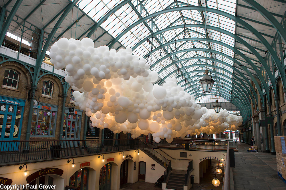 Covent Garden has commissioned artist Charles Pétillon to create a striking, large-scale installation, composed of 100,000 white balloons.The installation stretching 54 metres in length and 12 metres in width, incorporating gentle continuous pulsating white light to symbolise the beating of a heart. The work is titled 'Heartbeat'. will hang in the ceiling space of the South Hall Market Building.Pic Shows the Installation which opens to the public on 27th August 201515
