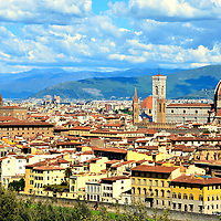Skyline of City from Piazzale Michelangelo in Florence, Italy<br /> To enjoy the elevated beauty of Florence, drive to the Oltrarno district and then along the five mile, tree-lined boulevard called Viale dei Colli until you reach Piazzale Michelangelo. Michelangelo Square has offered breathtaking, panoramic views since the lookout was built in 1869. Among the landmarks to admire are Cathedral of Florence (right), Palazzo Vecchio Tower (left) and the hills of Settignano and Fiesole.