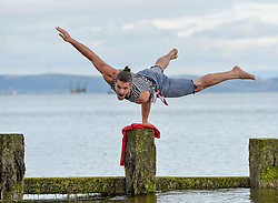 Acrobats Cal Harris practices his skills in the sea at Portobello in preparation for his show at this years Fringe, 'Arr we there yet?'<br /> <br /> © Dave Johnston/ EEm