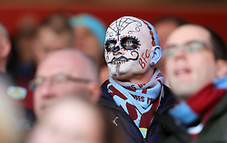 A Burnley fan in the stands in face-paint during the Premier League match at Turf Moor, Burnley.
