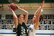 Mount Mansfield forward Perry Willett (5) guards Rice forward Lizzy Lyman (22) during the girls basketball game between the Rice Green knights and the Mount Mansfield Cougars at MMU High School on Friday night December 4, 2015 in Jericho. (BRIAN JENKINS/for the FREE PRESS)