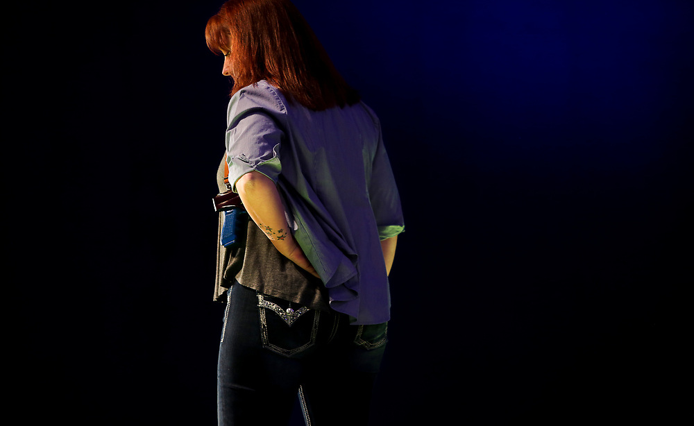 A model displays a concealed double pistol holster during the National Rifle Association (NRA) Carry Guard Expo Fashion Show in Milwaukee, Wisconsin, U.S., August 25, 2017.   REUTERS/Ben Brewer