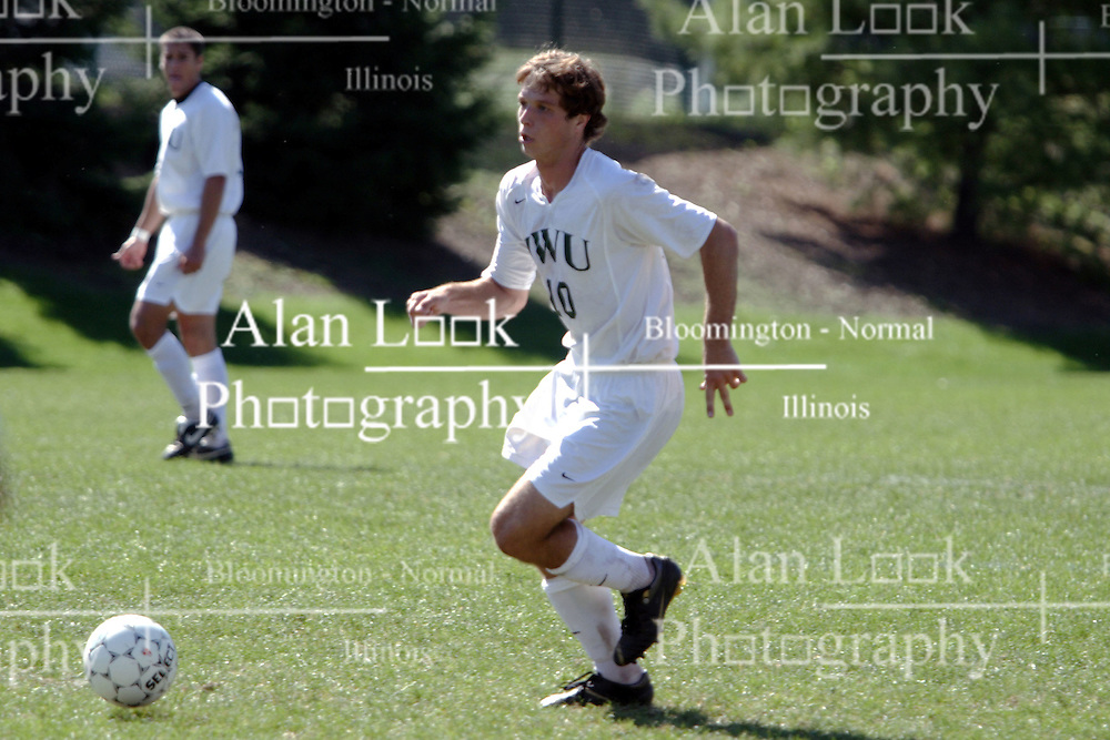 01 October 2006: Titan Paulo Michelini brings the ball up the field. The game remained scoreless until the 2nd overtime in which University of Dallas Crusaders Adam Lunger scored the Golden Goal to beat the Illinois Wesleyan Titans.  This game was played at Neis Field on the campus of Illinois Wesleyan University in Bloomington Illinois.