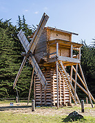 "Today's Fort Ross windmill is a full-size 1814 replica built by artisan craftsmen in Russia and reassembled in 2012 for the 200th anniversary of the fort's founding. At Fort Ross, the Russian-American Company made the first windmills in California (in 1814 and 1841), likely the first windmills west of the Mississippi River. The posttype mill (stolbovka) ground grain into flour for baking bread (for Settlement Ross and the Russians' Alaskan settlements) and also pounded tanbark for oil used in tanning leather. Fort Ross State Historic Park preserves a former Russian colony (1812-1842) on the west coast of North America, in what is now Sonoma County, California, USA. Visit Fort Ross and dramatic coastal scenery 11 miles north of Jenner on California Highway One.  Russian voyages greatly expanded California's scientific knowledge. For centuries before Europeans arrived, this site was called Metini and had been occupied by the Kashaya band of Pomo people who wove intricate baskets and harvested sea life, plants, acorns, deer, and small mammals. Sponsored by the Russian Empire, ""Settlement Ross"" was multicultural, built mostly by Alaskan Alutiiq natives and occupied by 300-400 native Siberians, Alaskans, Hawaiians, Californians, and mixed Europeans. Renamed ""Ross"" in 1812 in honor of Imperial Russian (Rossiia), Fortress Ross was intended to grow wheat and other crops to feed Russians living in Alaska, but after 30 years was found to be unsustainable. Fort Ross was sold to John Sutter in 1841, and his trusted assistant John Bidwell transported its hardware and animals to Sutter's Fort in the Sacramento Valley. Fort Ross is a landmark in European imperialism, which brought Spanish expanding west across the Atlantic Ocean and Russians spreading east across Siberia and the Pacific Ocean. In the early 1800s, Russians coming from the north met Spanish coming from the south along the Pacific Coast of California, followed by the USA arriving from the east in 1846 for the Mexican"