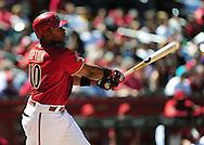Apr. 10 2011; Phoenix, AZ, USA; Arizona Diamondbacks outfielder .Justin Upton (10) reacts at bat against the Cincinnati Reds at Chase Field. Mandatory Credit: Jennifer Stewart-US PRESSWIRE