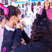 Hailey Tom gets a spider painted on her face at the Fall Festival at the McKinley County Courthouse Square Saturday afternoon.