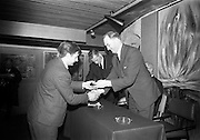 16/12/1965<br /> 12/16/1965<br /> 16 December 1965<br /> <br /> Irish apprentices who won the awards at the International Apprentices Competition held in Glasgow<br /> <br /> Picture shows Mr. George Colley (right) presenting a silver medal to Gerald McCarthy stonecutter from Ballyphehane Cork