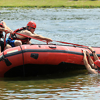 Andrew Douglas, left, a driver with the New Albany Fire Department, and Lieutenant Eddie Latham, also with the New Albany Fire Department, work of boat flip training for the Homeland Security Task Force 1 Training held Thursday at Veterans Park in Tupelo.
