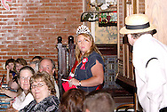 "Kristen Nader (standing, left) and J. Gary Thompson during Mayhem & Mystery's production of ""County Fair Commotion"" at the Spaghetti Warehouse in downtown Dayton, Monday, July 11, 2011."