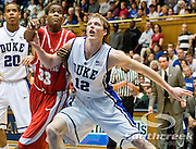 21 November 2009: Duke Junior Forward #12 Kyle Singler blocks out Radford (33) Jamal Curry freshman forward..Duke Rolls Past Radford 104-67 .Mandatory Credit: Mark Abbott / Southcreek Global