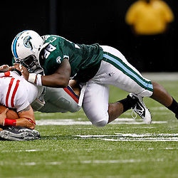 Sep 11, 2010; New Orleans, LA, USA; Mississippi Rebels quarterback Jeremiah Masoli (8) nearly loses his helmet as Tulane Green Wave defensive tackle Cedric Wilson (98) makes a tackle during the first half at the Louisiana Superdome.  Mandatory Credit: Derick E. Hingle