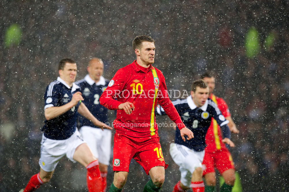 GLASGOW, SCOTLAND - Friday, March 22, 2013: Wales' Aaron Ramsey scores the equalising goal from the penalty spot against Scotland during the 2014 FIFA World Cup Brazil Qualifying Group A match at Hampden Park. (Pic by David Rawcliffe/Propaganda)