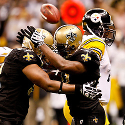 Oct 31, 2010; New Orleans, LA, USA; New Orleans Saints linebacker Jonathan Vilma (51) celebrates with defensive end Will Smith (91) following a sack against the Pittsburgh Steelers during the second half at the Louisiana Superdome. The Saints defeated the Steelers 20-10.  Mandatory Credit: Derick E. Hingle