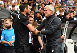 """Derby County manager Frank Lampard (left) and Southampton manager Mark Hughes shake hands prior to kick-off during a pre season friendly match at Pride Park, Derby. PRESS ASSOCIATION Photo. Picture date: Saturday July 21, 2018. Photo credit should read: Anthony Devlin/PA Wire. EDITORIAL USE ONLY No use with unauthorised audio, video, data, fixture lists, club/league logos or """"live"""" services. Online in-match use limited to 75 images, no video emulation. No use in betting, games or single club/league/player publications."""