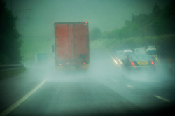 Driving  through heaving rain and spray on the M6 motorway, Preston, Lancashire, England, UK.