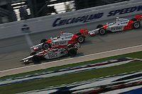 Dan Wheldon takes the checkered flag ahead of Helio Castroneves and Sam Hornish Jr.  Chicagoland Speedway,<br />