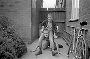 Neville and Lee messing in garden at Hawthorne Road, High Wycombe, UK, 1980s.