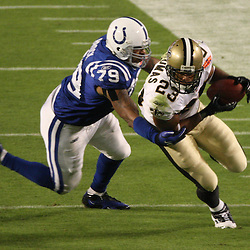 2010 February 07: New Orleans Saints running back Pierre Thomas (23) runs past Indianapolis Colts defensive tackle Raheem Brock (79) during a 31-17 win by the New Orleans Saints over the Indianapolis Colts in Super Bowl XLIV at Sun Life Stadium in Miami Gardens, Florida.