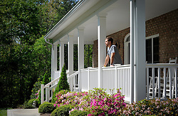 Brian Scott looks across a rolling front lawn towards the woods that surround his rustic ranch style home that sits on three acres in the Mooresville area. The front porch welcomes visitors to an open floor plan with natural accents that reflect the NASCAR driver's love of the outdoors.