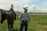 Pickup man Jay Shaw and  daughter at Miles City Bucking Horse Sale, Montana