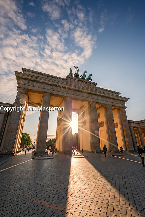 Evening sun shining through Brandenburg Gate in Berlin Germany