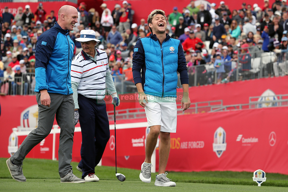 Europe's Niall Horan and Paul O'Connell (left) share a joke during a celebrity golf match ahead of the 41st Ryder Cup at Hazeltine National Golf Club in Chaska, Minnesota, USA.