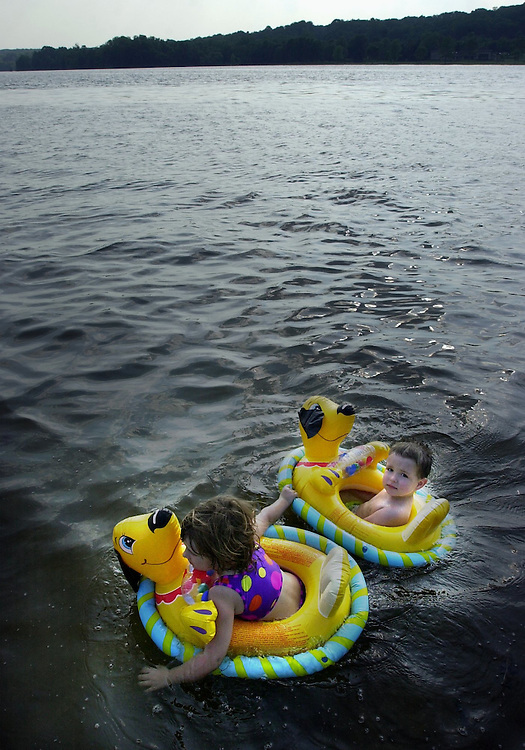 Monday, May 24, 2004.Dezera Dashae Davis, 4, pulles her brother Dakota Dashawn, 2, while swimming at Gifford Pinchot State Park, Monday, with their parents Bob and Hope of Hellam Township. With unseasonably warm temperatures, the family decided to take a dip to cool off.