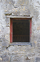 Window on stone farmyard stables in Westmeath Ireland