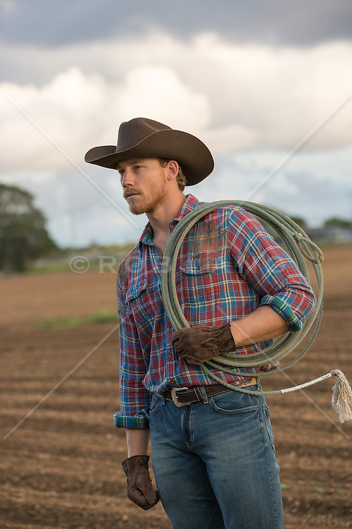 cowboy on a ranch with a lasso