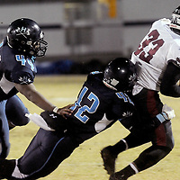 Hoggard's Julius Reynolds, left, and Yeremiya Andrews combine for a tackle on South Central High School's Shawn Furlow in the first round of football playoffs Friday November 14, 2014. (Jason A. Frizzelle)