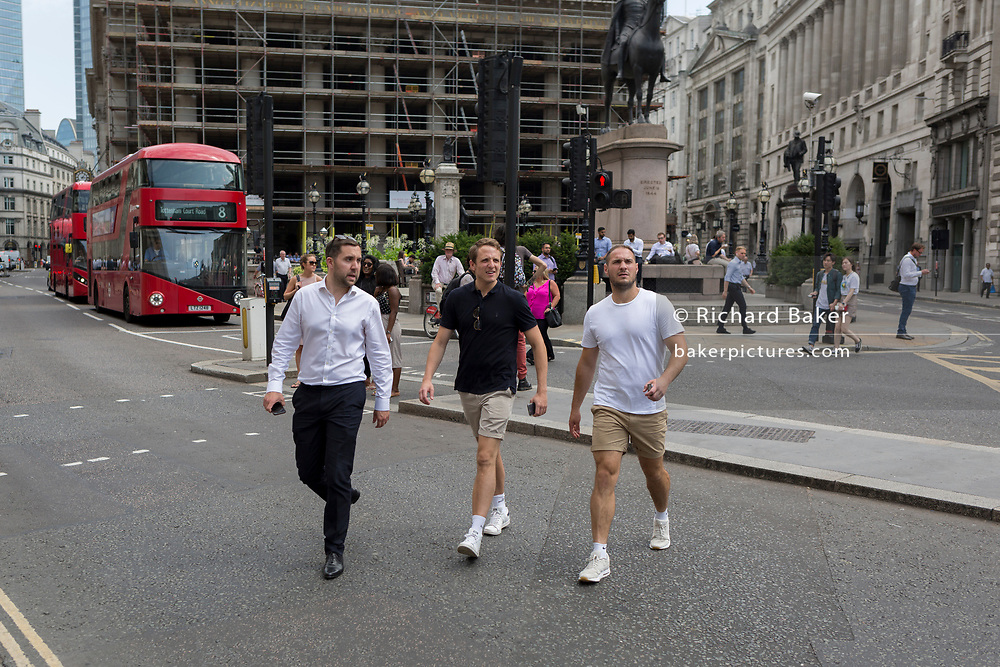 As heatwave temperatures climb to record levels - the hottest day of the year so far - Londoners in the City of London (the capital's financial district aka the Square Mile) took to enjoy informal dress codes including shorts and sports shirts, on 25th July 2019, in London, England.