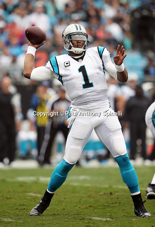 Carolina Panthers quarterback Cam Newton (1) throws a first quarter pass for a first down during the 2015 NFL week 3 regular season football game against the New Orleans Saints on Sunday, Sept. 27, 2015 in Charlotte, N.C. The Panthers won the game 27-22. (©Paul Anthony Spinelli)