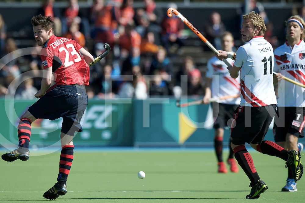 Amstelveen - Euro Hockey league KO16.Amsterdamse H&BC - Berliner HC.foto: Robert Tigges (white) and Martin Zwicker (red)..FFU PRESS AGENCY COPYRIGHT FRANK UIJLENBROEK.