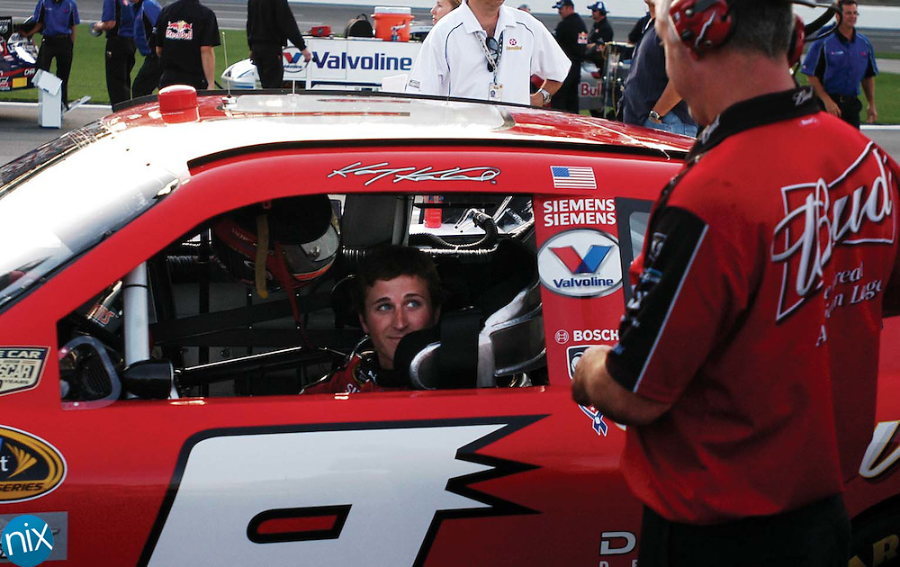 Kasey Kahne speaks with a crew members after qualifying for the Coca-Cola 600 Thursday night at Lowe's Motor Speedway.