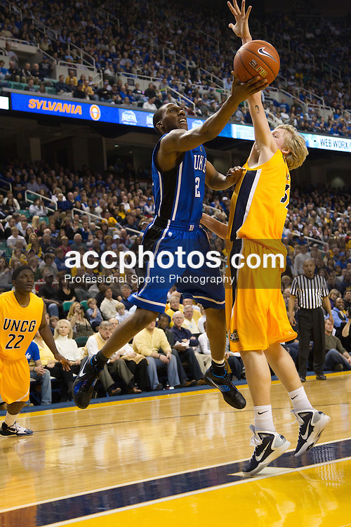 GREENSBORO, NC - DECEMBER 29: Nolan Smith #2 of the Duke Blue Devils jumps to a make a basket over the defense of the UNC-Greensboro Spartans on December 29, 2010 at the Greensboro Coliseum in Greensboro, North Carolina. Duke won 108-62. (Photo by Peyton Williams/Getty Images) *** Local Caption *** Nolan Smith