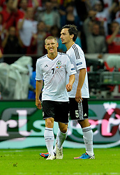 A dejected Bastian Schweinsteiger reflects after Mario Balotelli scores his team's second goal during the UEFA EURO 2012 semi final match between Germany and Italy at the National Stadium on June 28, 2012 in Warsaw, Poland.