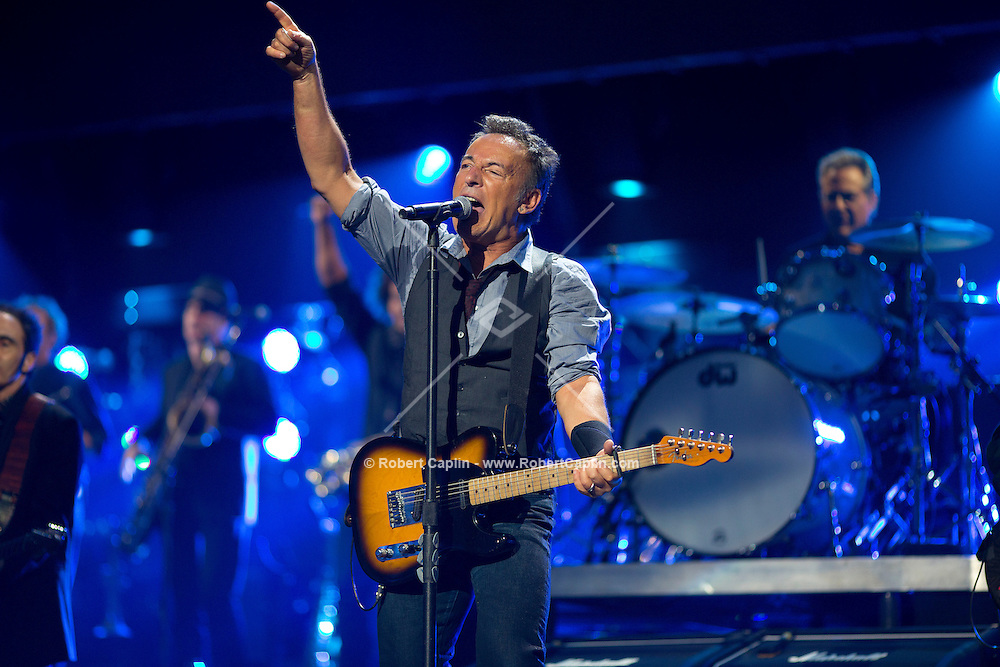 Bruce Springsteen & the E Street Band perform at the 12-12-12 fundraising concert to aid the victims of Hurricane Sandy, will take place on December 12, 2012 at Madison Square Garden. The concert featured The Rolling Stones, Bon Jovi, Eric Clapton, Dave Grohl, Billy Joel, Alicia Keys, Chris Martin, Bruce Springsteen & the E Street Band, Eddie Vedder, Roger Waters, Kanye West, The Who, and Paul McCartney. All the proceeds went go to the Robin Hood Relief Fund. Robin Hood, the largest independent poverty fighting organization in the New York area, will insure that every cent raised will go to non-profit groups that are helping the tens of thousands.of people throughout the tri-state area who have been affected by Hurricane Sandy...Photo © Robert Caplin..