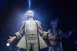 "© Licensed to London News Pictures. 25/02/2014. London, England. Pictured: Martin Greis performing as ""The Beast"" (photocall only, not in press performance). ""Mozart Undone"", is a Theatre Concert created by Betty Nansen Teatret and Cederholm & Hellemann Bros which will be performed from 25 February to 1 March 2014 at the Barbican Theatre, London. Familiar Mozart melodies are made fresh by rock, pop and jazz anthems sung in English. Performers appear in costumes worn by decadent 18th century aristocrats and stand in cascades of water or cavort in foam.  Photo credit: Bettina Strenske/LNP"