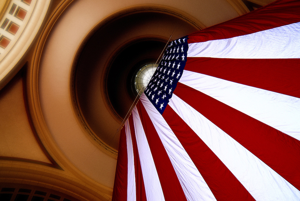 The American flag is suspended from the inside ceiling of the Boston Harbor Hotel rotunda at Rowes Wharf on the Boston waterfront.