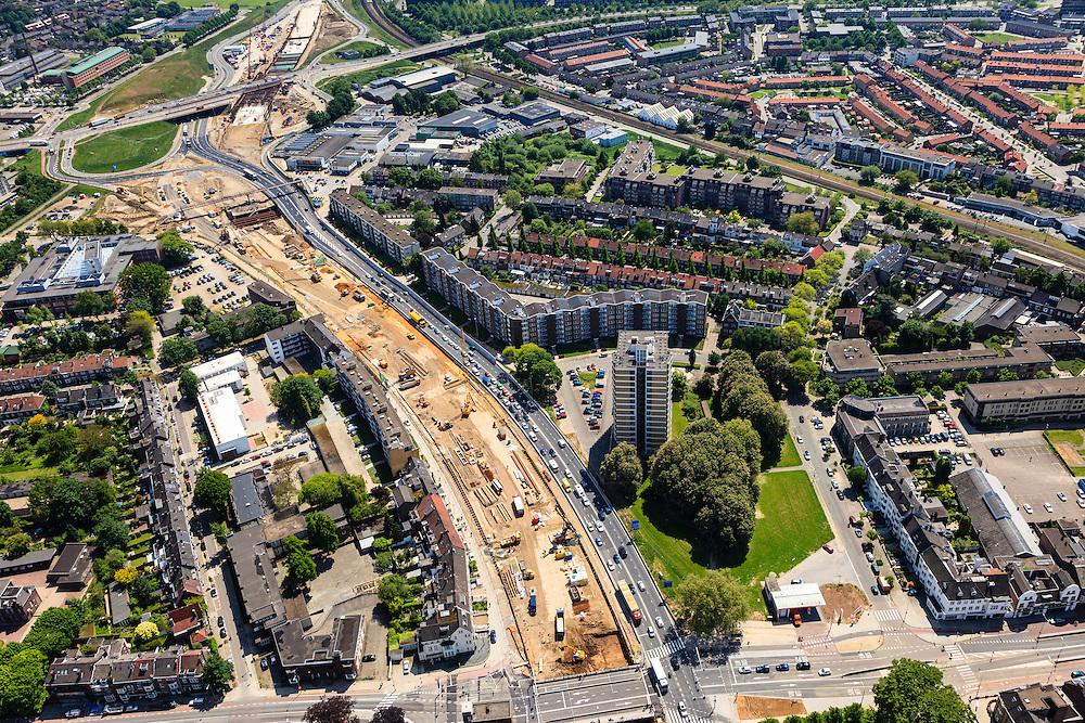 Nederland, Limburg, Maastricht, 27-05-2013; bouwwerkzaamheden voor de A2 traverse, De Groene Loper. <br /> Tunnelbouwkuip Europaplein.<br /> De snelweg A2 gaat ondergronds, er wordt een gestapelde tunnel gebouwd (2 wegen boven elkaar). Het plan moet voor een betere bereikbaarheid en leefbaarheid van Maastricht zorgen en ook voor een betere doorstroming op de A2.<br /> Construction works for motorway A2 crossing Maastricht, the so-called Green Carpet.<br /> The A2 motorway goes underground, a stacked tunnel is  built with two roads above each other). The plan should provide better accessibility and traffic flow.<br /> luchtfoto (toeslag op standard tarieven);<br /> aerial photo (additional fee required);<br /> copyright foto/photo Siebe Swart.