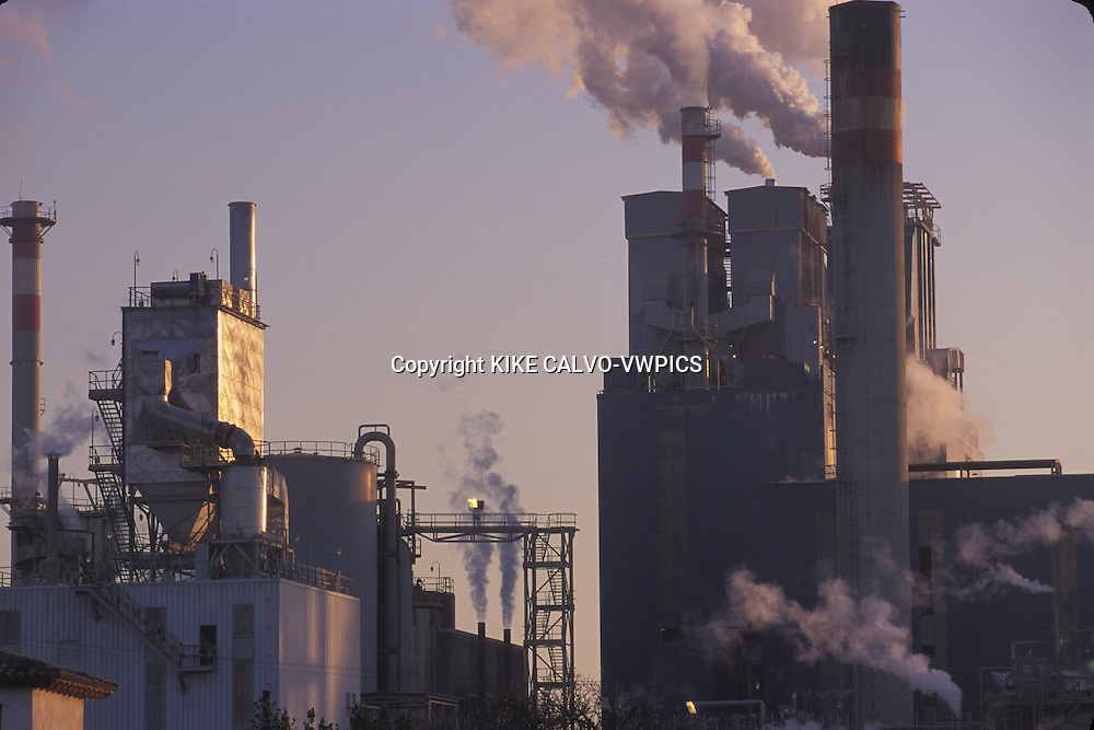 Paper factory blowing smoke and pollution into the air