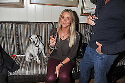 JANA KNIGHT and her dog Jackson at the 10th anniversary of George in association with The Dog's Trust held at George, 87-88 Mount Street, Mayfair, London on 13th September 2011.